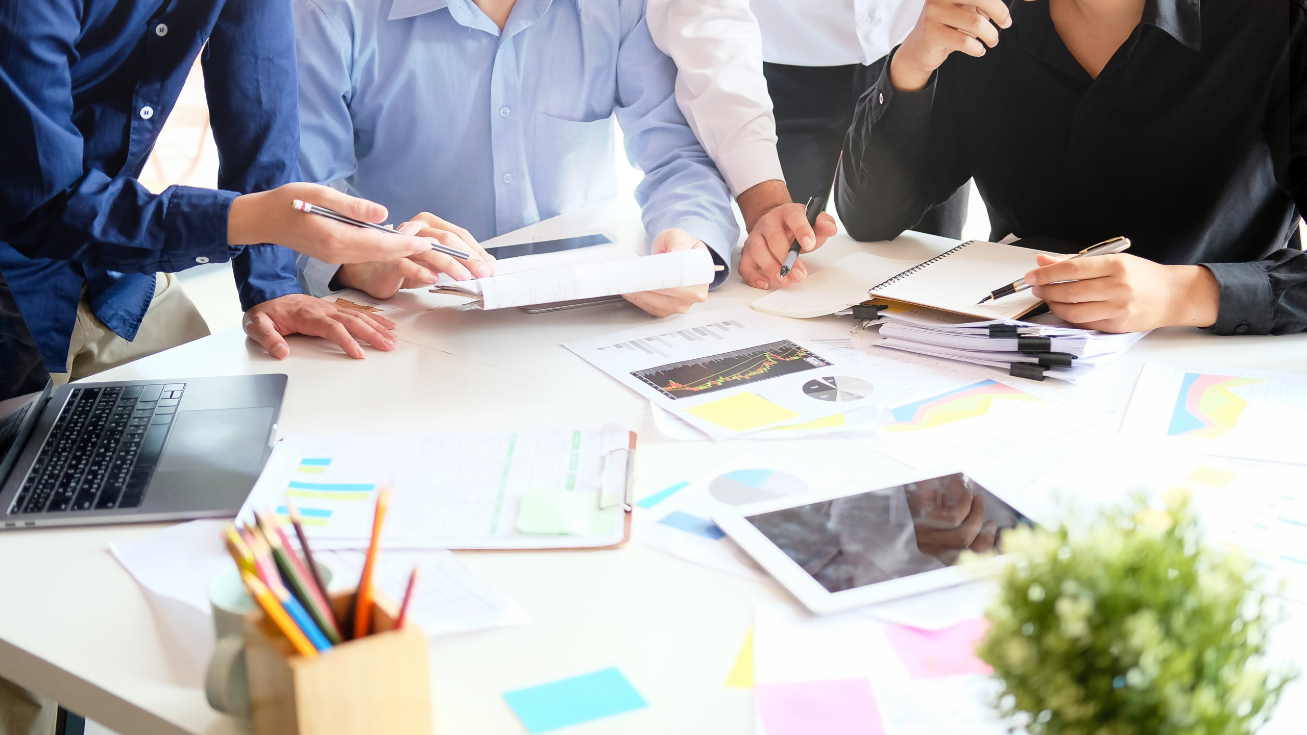 Strategy startup business with young businessman meeting on desk